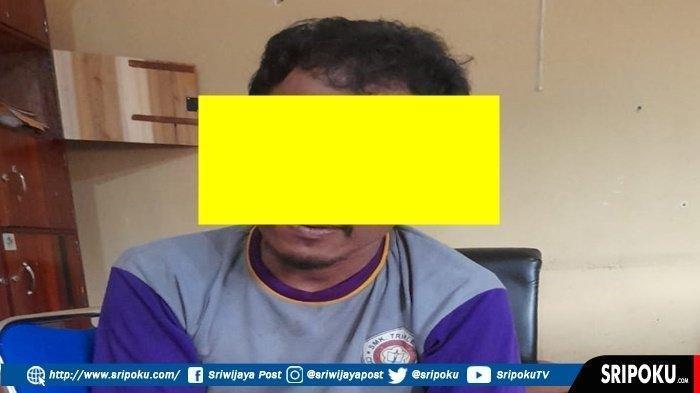 Pria asal Tebing Tinggi, Sumatera Utara, WW (39), saat di kantor polisi seusai menculik wanita berinisial NR (26).