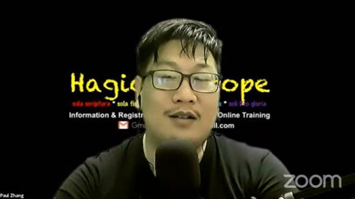 YouTuber Jozeph Paul Zhang bereaksi santai sambil tertawa saat mengetahui kanal YouTube miliknya telah diblokir, Selasa (20/4/2021).