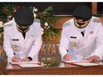 gibran-rakabuming-raka-dan-teguh-prakosa-telah-resmi-dilantik-jumat-2622021.jpg