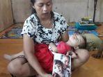 leha-menunjukkan-potret-salah-satu-anaknya-yang-meninggal_20181023_071600.jpg