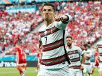megabintang-portugal-cristiano-ronaldo-melakukan-selebrasi-seusai-mencetak-gol-ke-gawang-hungaria.jpg