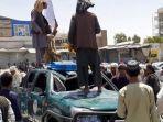 pejuang-taliban-berdiri-di-afganistan.jpg