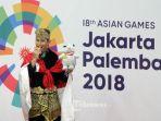 pesilat-indonesia-sugianto-pada-upacara-pengalungan-medali-final-tunggal-putra_20180829_170550.jpg