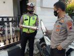 pihak-kepolisian-mengamankan-barang-bukti-knalpot-yang-di-rusak-seorang-pria.jpg