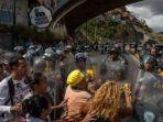 protes-di-caracas-venezuela-terkait-ketersediaan-daging-babi_20180102_111100.jpg