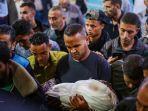 sejumlah-pria-palestina-memakamkan-anaknya-yang-menjadi-korban-serangan-roket-israel-di-jalur-gaza.jpg