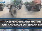 viral-video-aksi-pengendara-motor-di-tengah-truk.jpg
