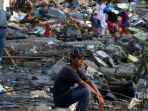 warga-korban-gempa-bumi-dan-tsunami-palu_20181015_162505.jpg